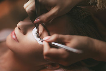 Image of a lady getting a beautiful eyebrow shape and lash extensions